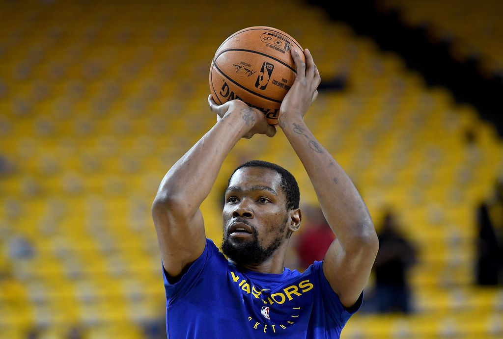 OAKLAND, CA - APRIL 28:  Kevin Durant #35 of the Golden State Warriors warms up shooting prior to playing the Houston Rockets in Game One of the Second Round of the 2019 NBA Western Conference Playoffs at ORACLE Arena on April 28, 2019 in Oakland, California. NOTE TO USER: User expressly acknowledges and agrees that, by downloading and or using this photograph, User is consenting to the terms and conditions of the Getty Images License Agreement.  (Photo by Thearon W. Henderson/Getty Images)