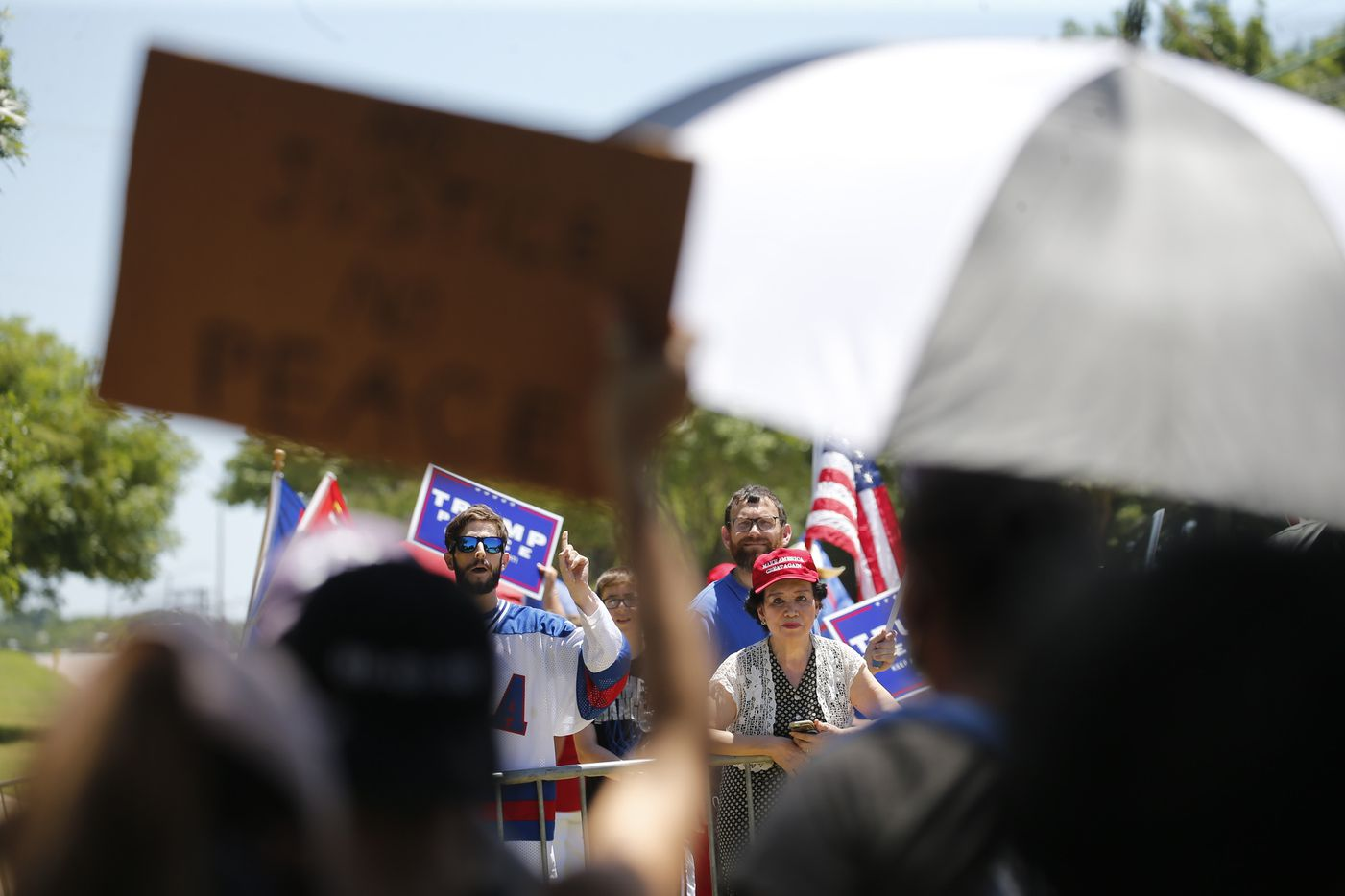 Anti-Trump protesters (foreground) and Trump supporters chant at each other across the street from Gateway Church in Dallas, on Thursday, June 11, 2020. George Floyd died in police custody in Minneapolis on May 25. Minneapolis police officer Derek Chauvin, who had his knee on the neck of Floyd for at least five minutes has been charged with murder and manslaughter. (Vernon Bryant/The Dallas Morning News)