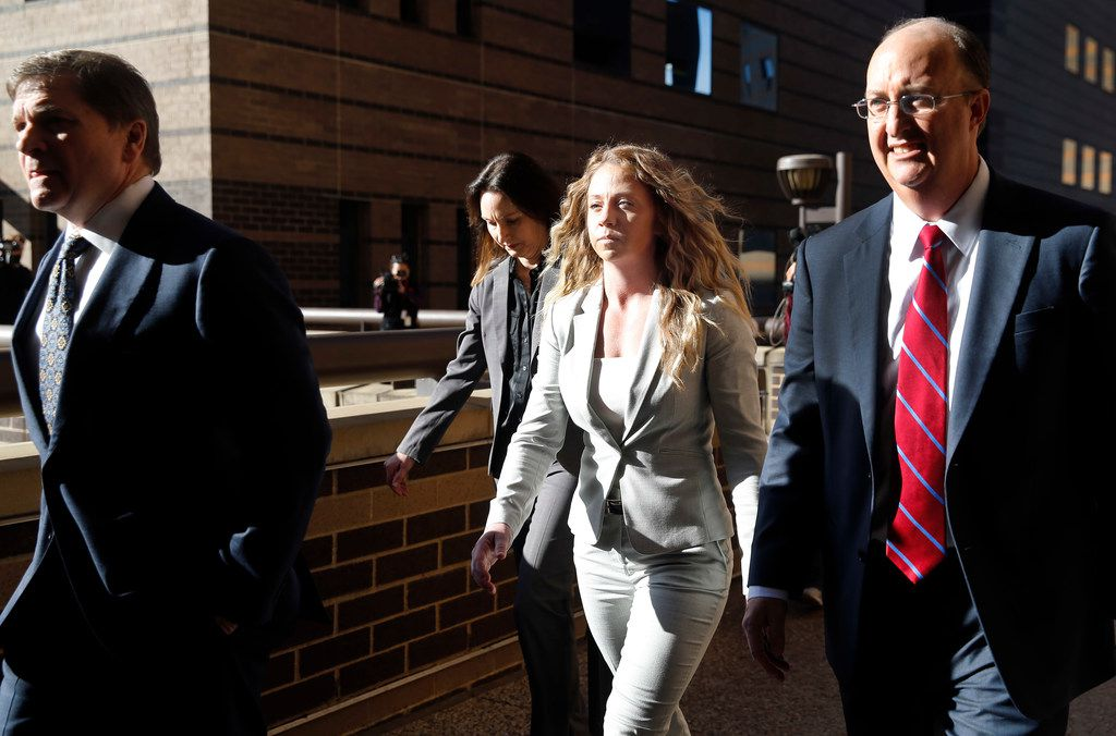 Former Dallas police officer Amber Guyger (center) leaves the Frank Crowley Courts Building in downtown Dallas with her attorneys Toby Shook (left) and Robert Rogers (right) after a court appearance in January.