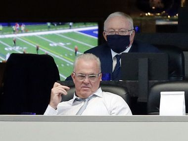 Dallas Cowboys owner Jerry Jones and his son Stephen Jones watch their team trail the Cleveland Browns in the second half at AT&T Stadium in Arlington, Texas, Sunday, October 4, 2020. The Cowboys lost, 48-39.