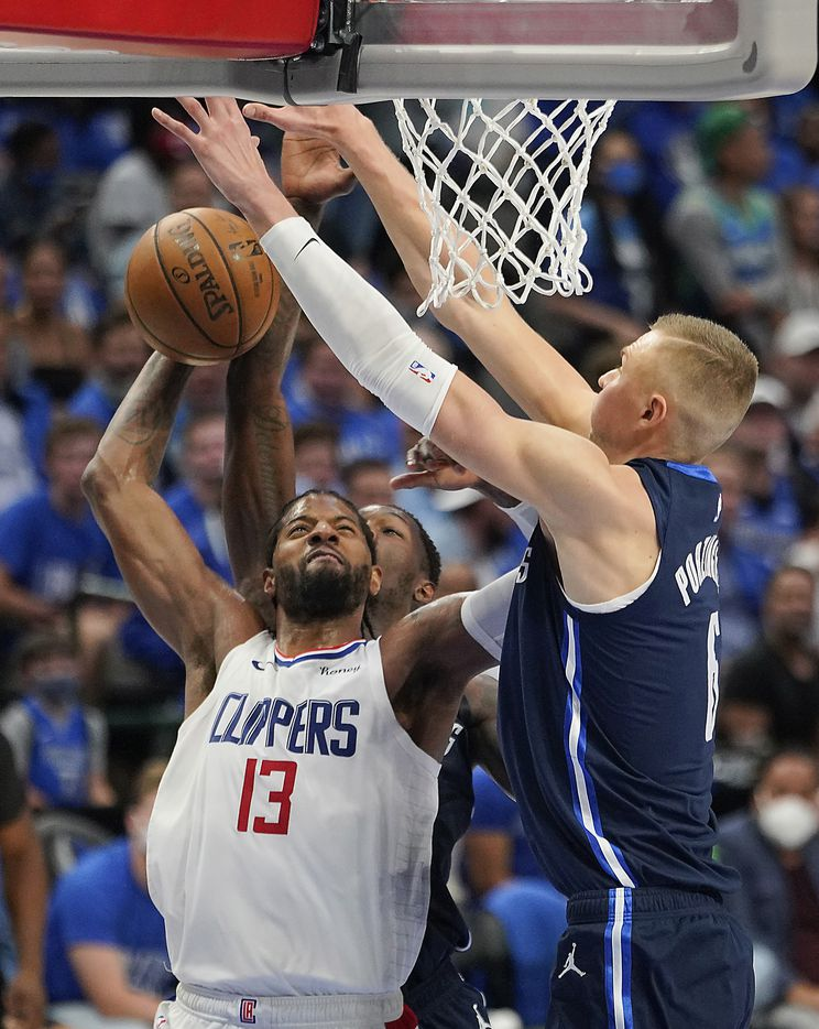 LA Clippers guard Paul George (13) drives to the basket against Dallas Mavericks center Kristaps Porzingis (6) during the second half  of an NBA playoff basketball game at American Airlines Center on Friday, May 28, 2021, in Dallas.