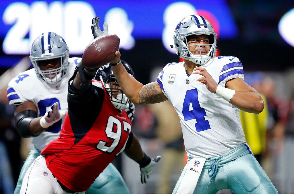 Atlanta Falcons defensive tackle Grady Jarrett (97) almost gets to Dallas Cowboys quarterback Dak Prescott (4) on a first quarter pass at Mercedes-Benz Stadium in Atlanta, Georgia, Sunday, November 12, 2017. (Tom Fox/The Dallas Morning News)
