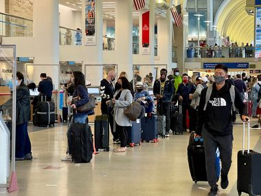 Passengers wait in line at the American Airlines check-in counters at the Los Angeles International Airport in April.