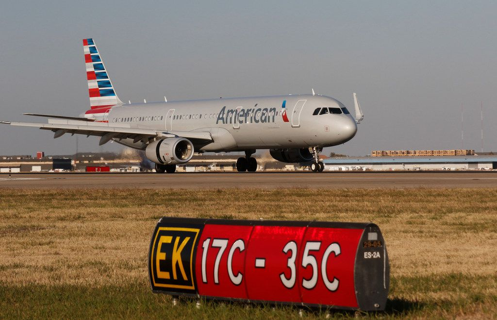 An American Airlines Airbus A321 lands on Runway 17-C at Dallas Fort Worth (DFW) International Airport Monday, November 27, 2017. The airport will have improvements made to Runway 17-C thanks to a $52 million dollar grant from the FAA and is part of the Airport Improvement Program. The runway is called 17-C if the plane is taking off or landing to the south. (Ron Baselice/The Dallas Morning News)