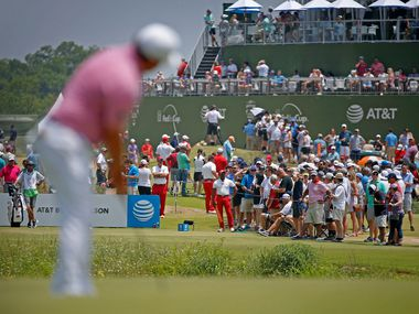Fans gather near the 17th tee box as Tom Lovelady watches his putt on the 17th green during the third round of AT&T Byron Nelson at Trinity Forest Golf Club in Dallas, Saturday, May 19, 2018.