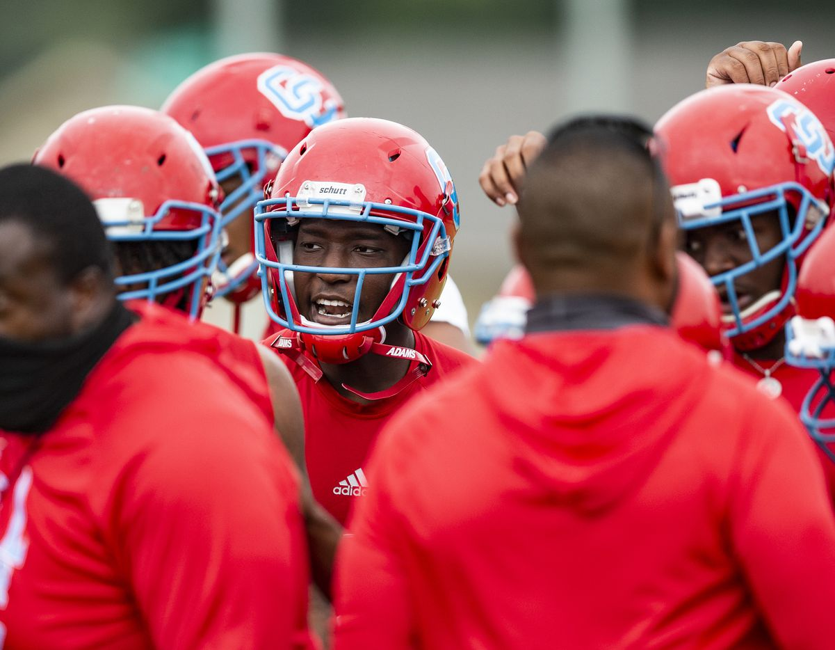 Carter senior running back/linebacker Jakourien Hooker-Duncan, center, participates during the first day of football practice at Carter High School in Dallas, Monday, August 2, 2021. (Brandon Wade/Special Contributor)