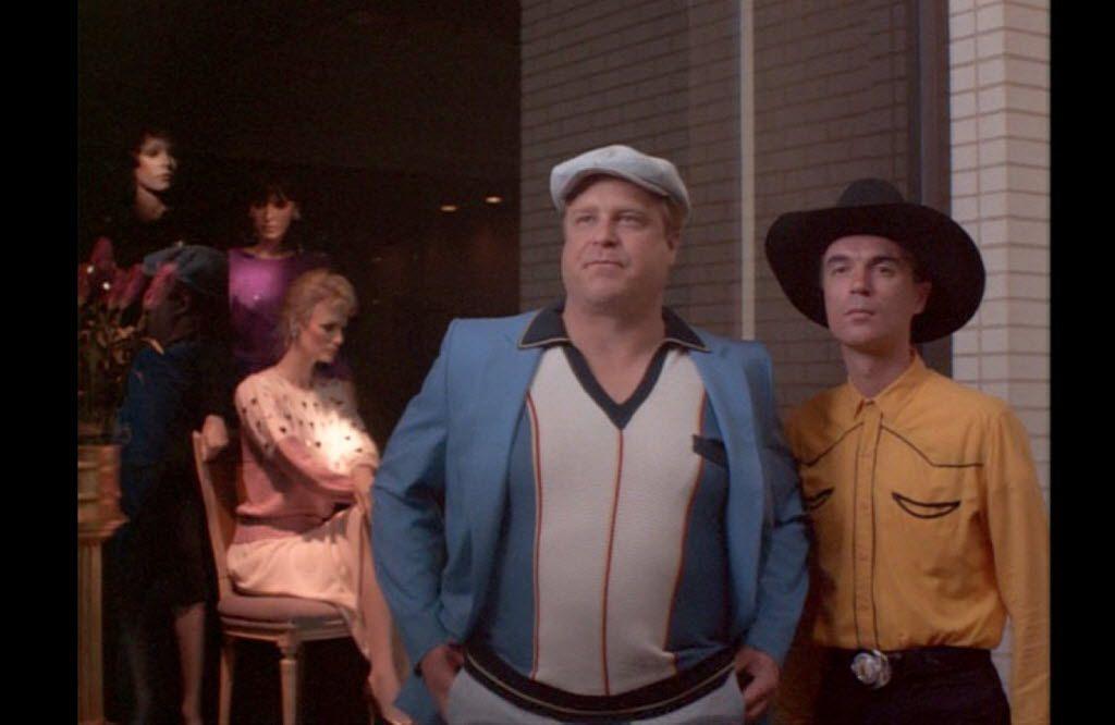 David Byrne and John Goodman appear in True Stories (1986).
