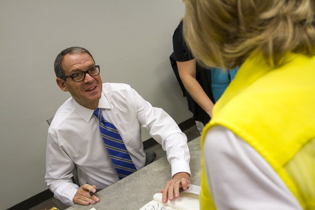 Best-selling author Daniel Silva signs copies of his new novel, The Black Widow, before his appearance at the Jewish Community Center in Dallas on Sunday, July 17.