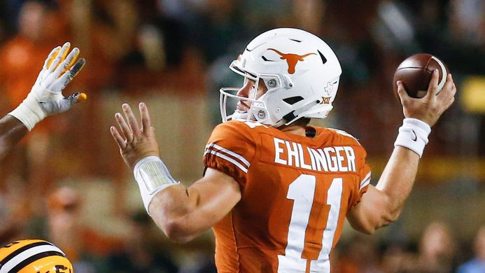 Texas quarterback Sam Ehlinger (11) fires off a pass over LSU linebacker K'Lavon Chaisson (18) during the third quarter of a college football game between the University of Texas and Louisiana State University on Saturday, Sept. 7, 2019 at Darrell Royal Memorial Stadium in Austin, Texas.