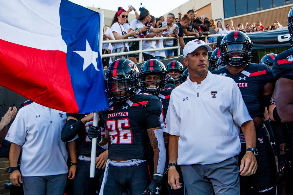 Running back Ta'Zhawn Henry #26 and head coach Matt Wells of Texas Tech stand in the tunnel before the college football game between the Texas Tech Red Raiders and the UTEP Miners at Jones AT&T Stadium on September 07, 2019 in Lubbock, Texas.