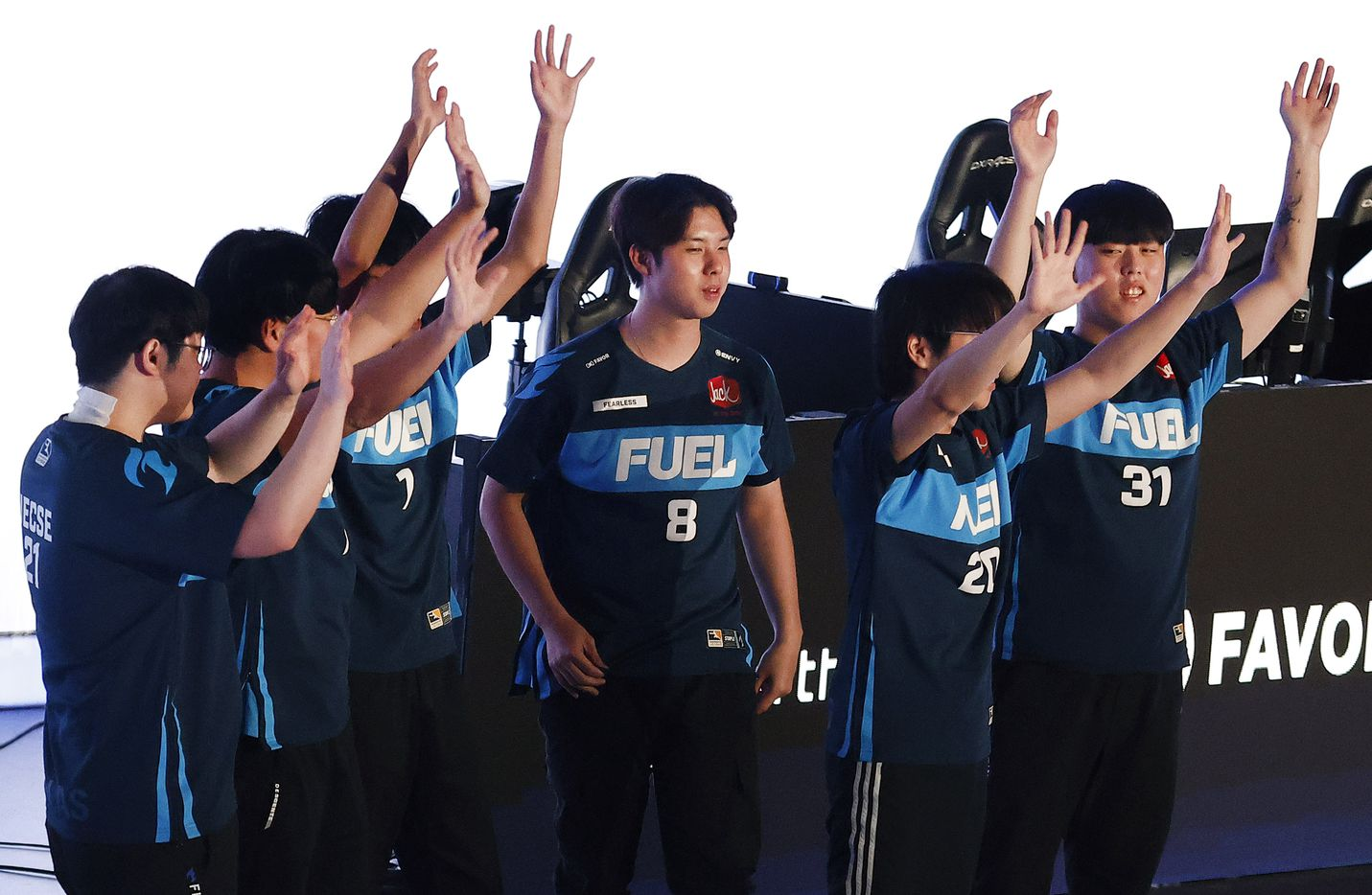 The Dallas Fuel team acknowledges their fans after defeating the Houston Outlaws in their Overwatch League match at Esports Stadium Arlington Friday, July 9, 2021. The Fuel defeated Houston in The Battle for Texas, 3-0. It was the first in-person live competition for fans in over a year. Houston competed from their hometown. (Tom Fox/The Dallas Morning News)
