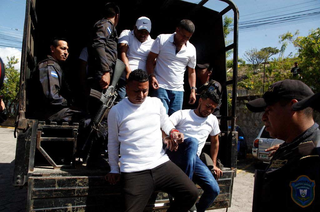 Douglas Bustillo, top left, and Mariano Diaz Chavez, top right, Oscar Aroldo Torres Velazquez, bottom left, and Henry Javier Hernandez Rodriguez, bottom right, accused in the murder of Honduran indigenous and environmental rights activist Berta Caceres, are led in handcuffs to court by police in Tegucigalpa, Honduras, on Nov. 29. Seven of the eight accused of Caceres' murder were found guilty by a court and will be sentence in January.