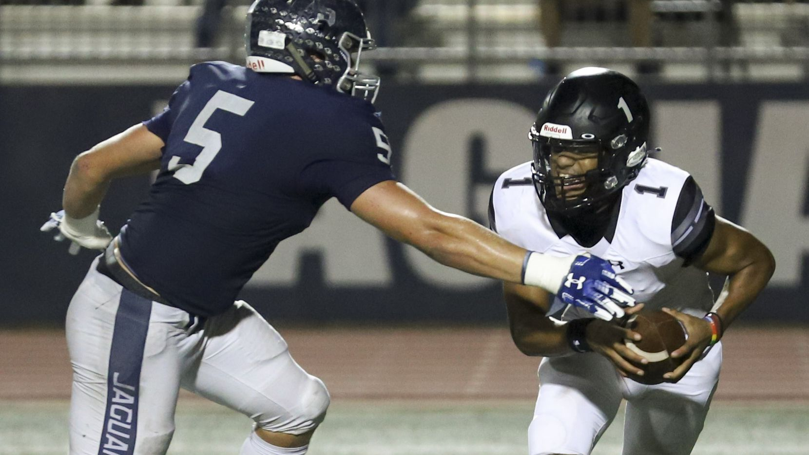 Flower Mound defensive end Stone Eby (5) sacks Mansfield Timberview quarterback Simeon Evans (1) during the second half at Neal E. Wilson Stadium in Flower Mound, Friday, October 9, 2020.