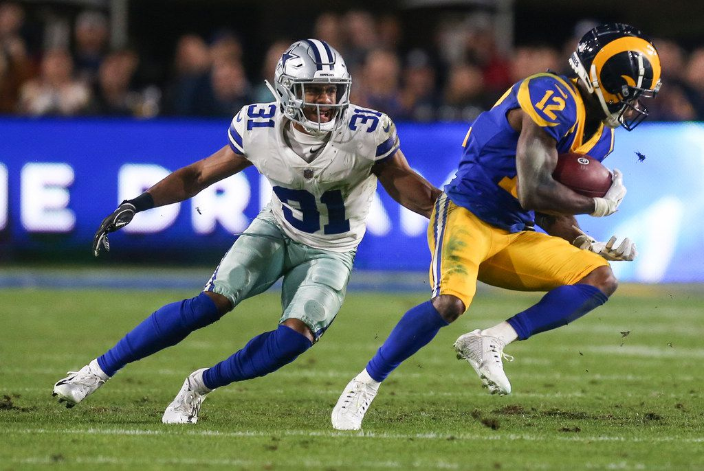 Dallas Cowboys cornerback Byron Jones (31) works to stop Los Angeles Rams wide receiver Brandin Cooks (12) during the first half of a NFC divisional playoff game between the Dallas Cowboys and the Los Angeles Rams on Saturday, Jan. 12, 2019 at Los Angeles Memorial Coliseum in Los Angeles. (Ryan Michalesko/The Dallas Morning News)