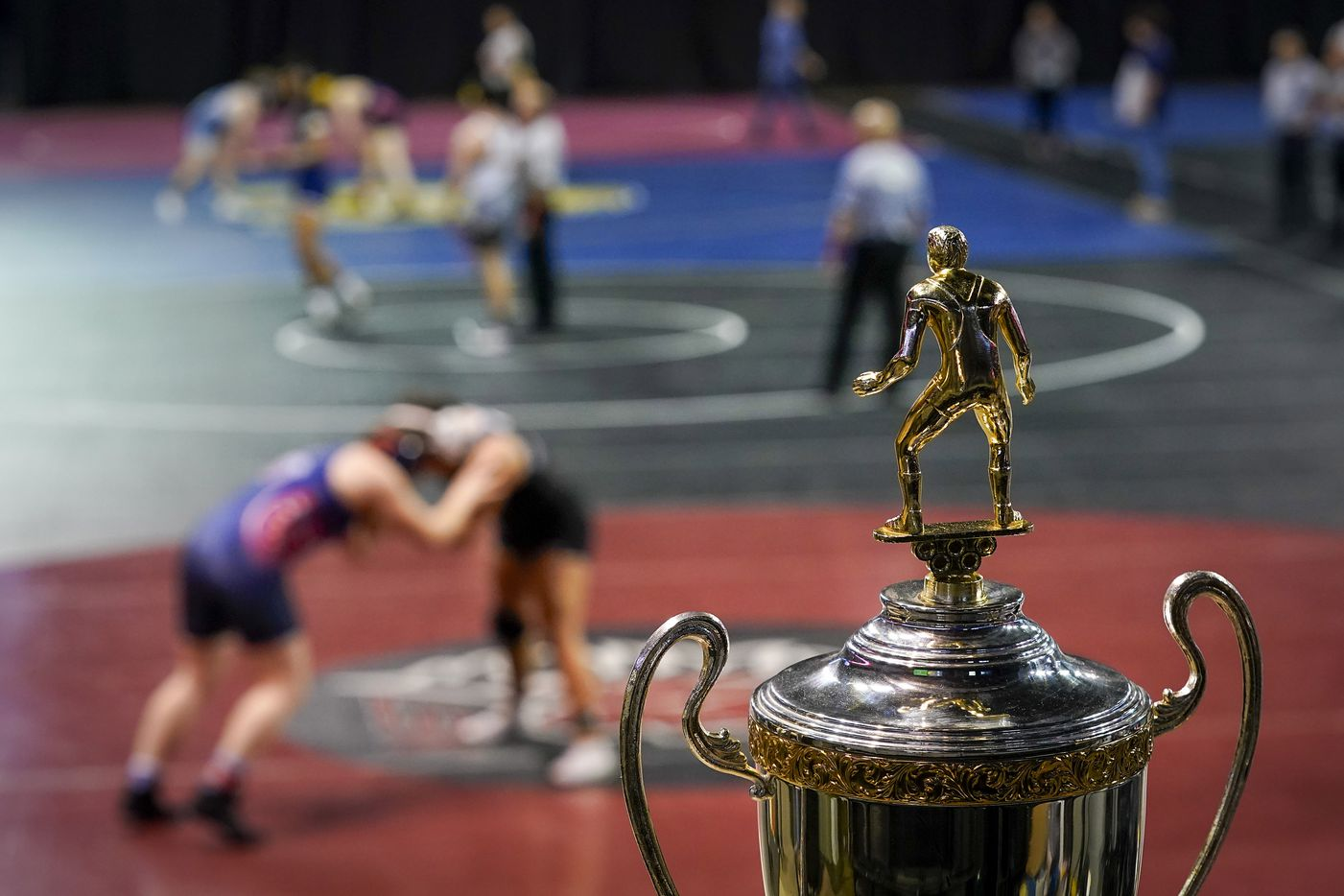 The championship trophy is seen as wrestlers compete during the NCWA national championships at the Allen Events Center on Friday, March 13, 2020, in Allen, Texas.