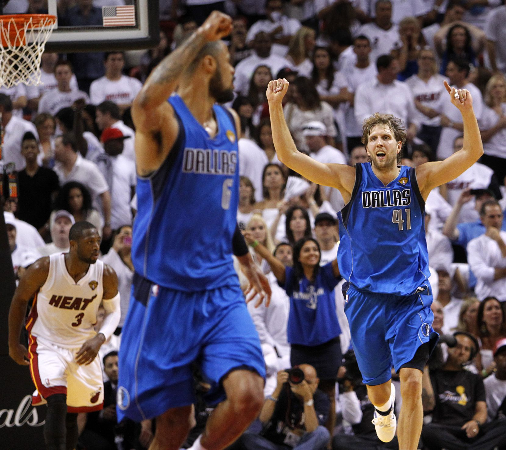 Dirk Nowitzki (41) and Tyson Chandler (6) run downcourt after Nowitzki's layup in the final minute of Game 6 of the NBA Finals on Sunday, June 12, 2011, at AmericanAirlines Arena Miami.
