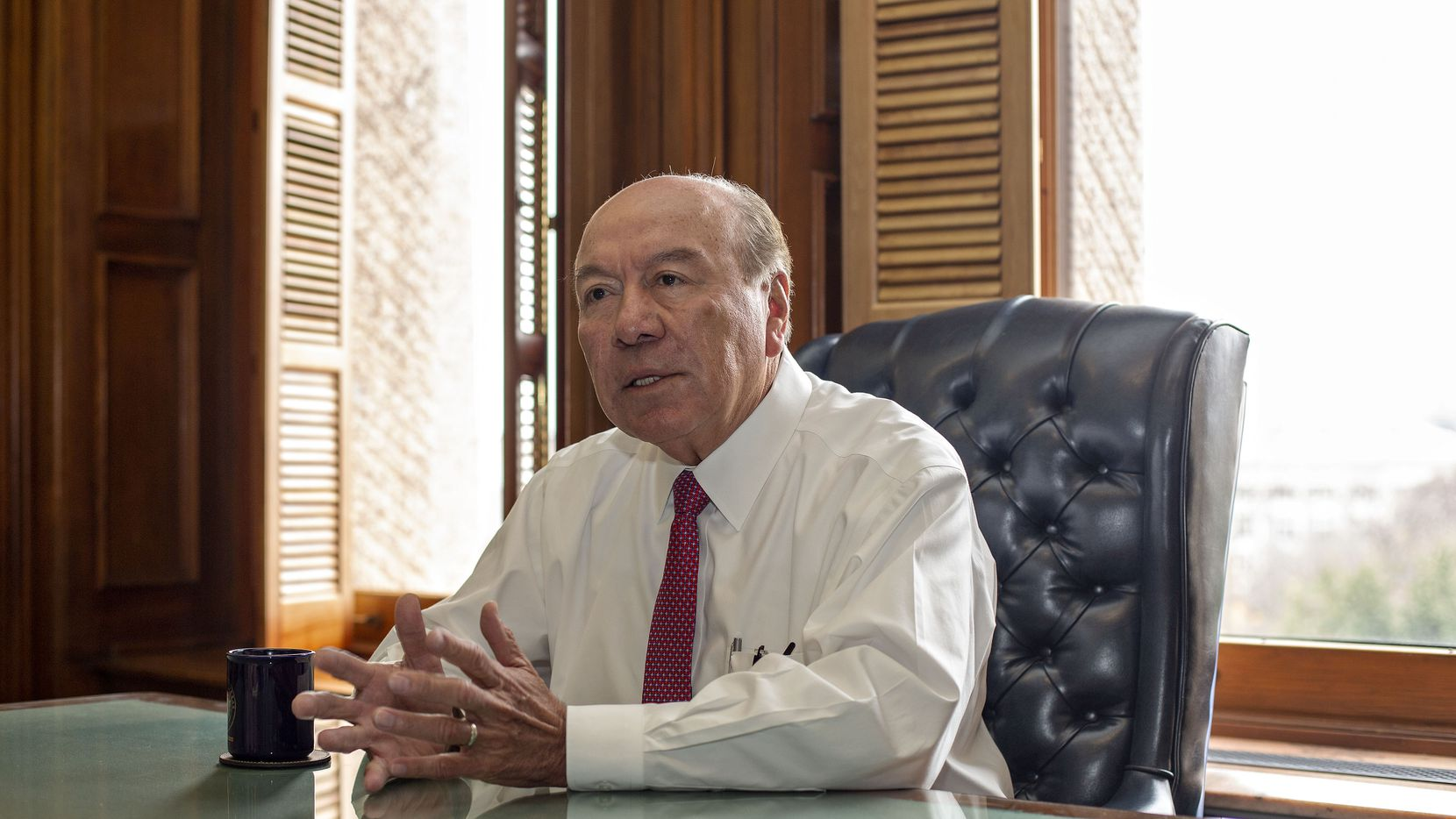 """Sen. Juan """"Chuy"""" Hinojosa, D-McAllen, shown at his Capitol office in 2019, says he doesn't believe a border wall will work. But somebody has to do something about the crisis at the border, he said Thursday."""