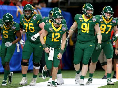 NEW ORLEANS, LOUISIANA - JANUARY 01: Charlie Brewer #12 of the Baylor Bears reacts with teammater after his team scored a touchdown against the Georgia Bulldogs during the Allstate Sugar Bowl at Mercedes Benz Superdome on January 01, 2020 in New Orleans, Louisiana.