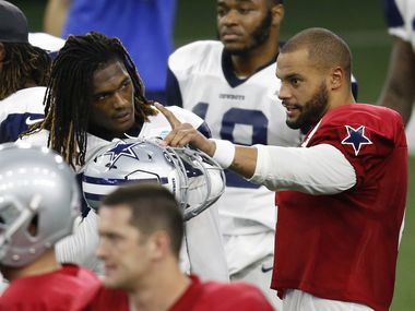 Dallas Cowboys quarterback Dak Prescott (4) talks to Dallas Cowboys wide receiver CeeDee Lamb (88) during a break in practice at training camp inside the Ford Center at the Dallas Cowboys headquarters at The Star in Frisco, Texas on Tuesday, August 18, 2020.