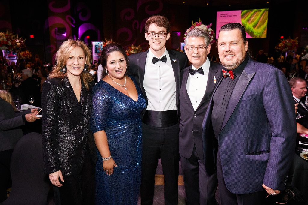 Shown at the Cotes du Coeur gala are (from left) Terri Gallagher, Keli Jenkins, Greyson Gallagher, Tim Gallagher and Mike Jenkins. Tim, a heart transplant recipient, and his wife, Terri, chaired the event.
