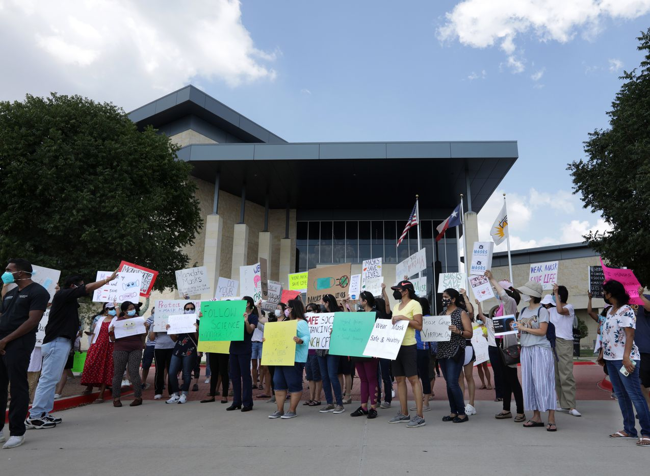 Community members seeking better COVID-19 protections gather during a protest at the Frisco ISD Administration Building in Frisco, TX, on Aug. 26, 2021.