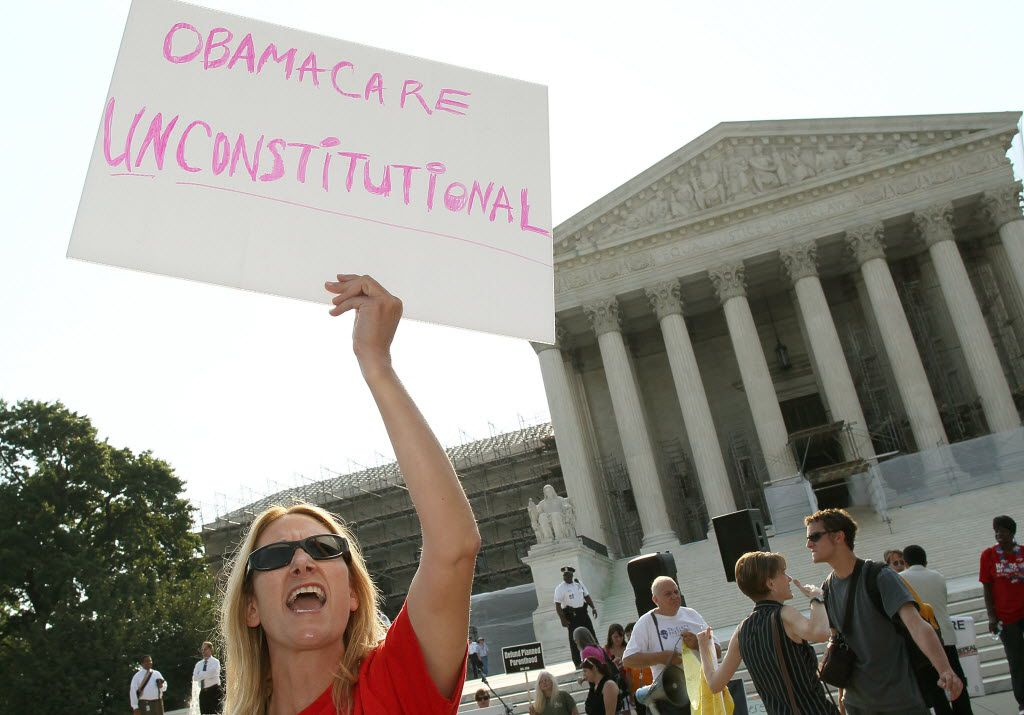 WASHINGTON, DC - JUNE 28: A woman protests against the Obama administrations health care plan during a protest in front of the U.S. Supreme Court, on June 28, 2012 in Washington, DC. Today the high court is expected to rule on the constitutionality of the sweeping health care law championed by President Barack Obama.  (Photo by Mark Wilson/Getty Images) 07022012xNEWS