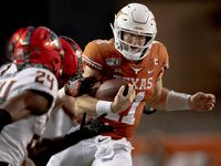 Texas quarterback Sam Ehlinger (11) runs the ball against Oklahoma State on Saturday, Sept. 21, 2019, at Royal Texas Memorial Stadium in Austin, Texas. The host Longhorns won, 36-30.
