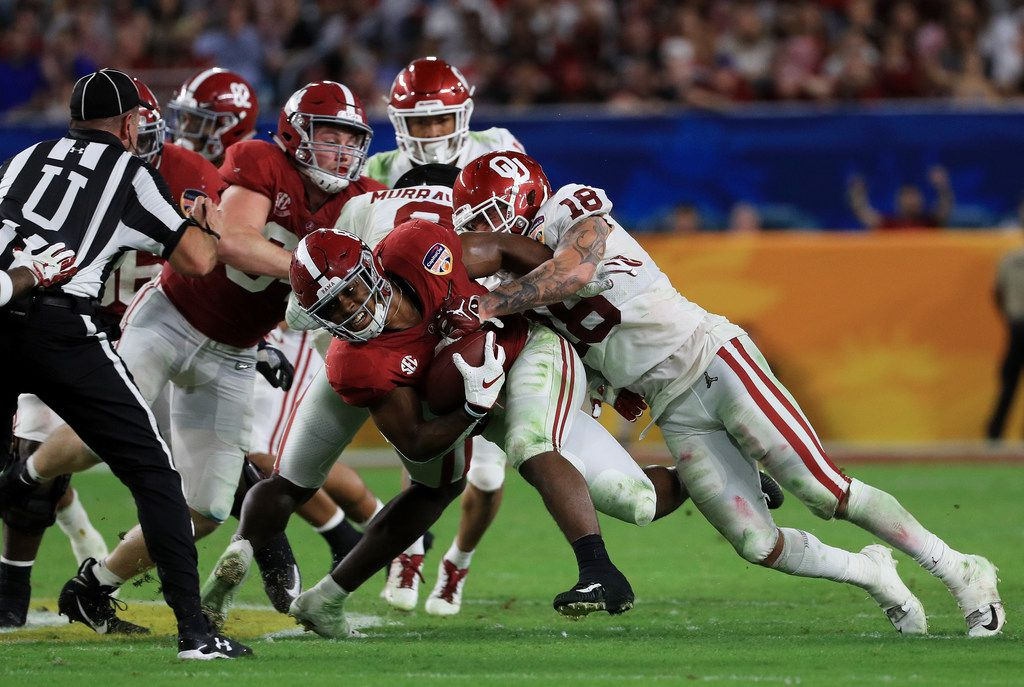 MIAMI, FL - DECEMBER 29: Curtis Bolton #18 of the Oklahoma Sooners makes the tackle on Josh Jacobs #8 of the Alabama Crimson Tide in the third quarter during the College Football Playoff Semifinal against the Oklahoma Sooners at the Capital One Orange Bowl at Hard Rock Stadium on December 29, 2018 in Miami, Florida.  (Photo by Mike Ehrmann/Getty Images)