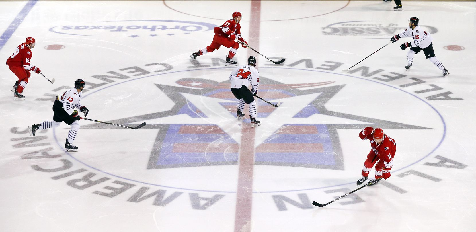 The Allen Americans and Rapid City Rush hockey players compete during the season opener at the Allen Event Center in Allen, Texas, Friday, December 18, 2020. This is the first professional hockey game in the metroplex since March. (Tom Fox/The Dallas Morning News)