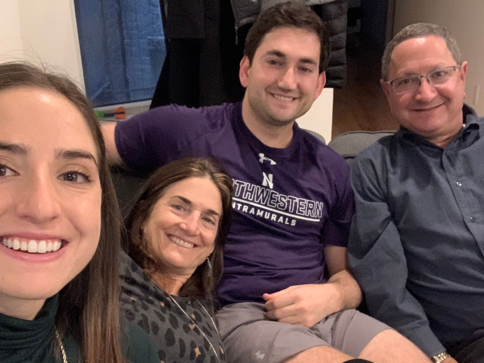 Rachel Hersh (left) is shown with her mom, Julie, brother Daniel, and dad, Ken, in 2019 when Ken and Julie visited their children, who live and work in New York. The selfie was taken by Rachel.