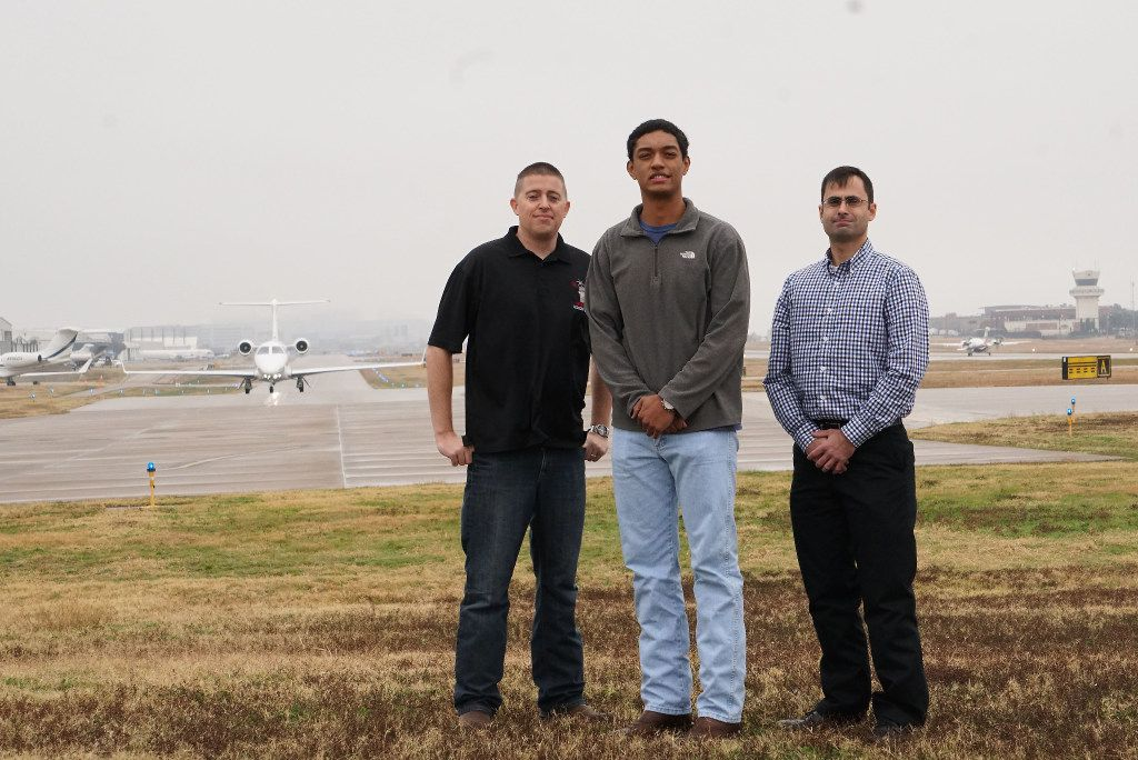 Air traffic controller Marc Gough (left) alerted pilot Daniel Luna (center) and FAA inspector Cristóbal Diaz that smoke was spilling from the front of their plane during a flight. They're pictured at the north end of Addison Airport's single runway. (Lawrence Jenkins/Special Contributor)