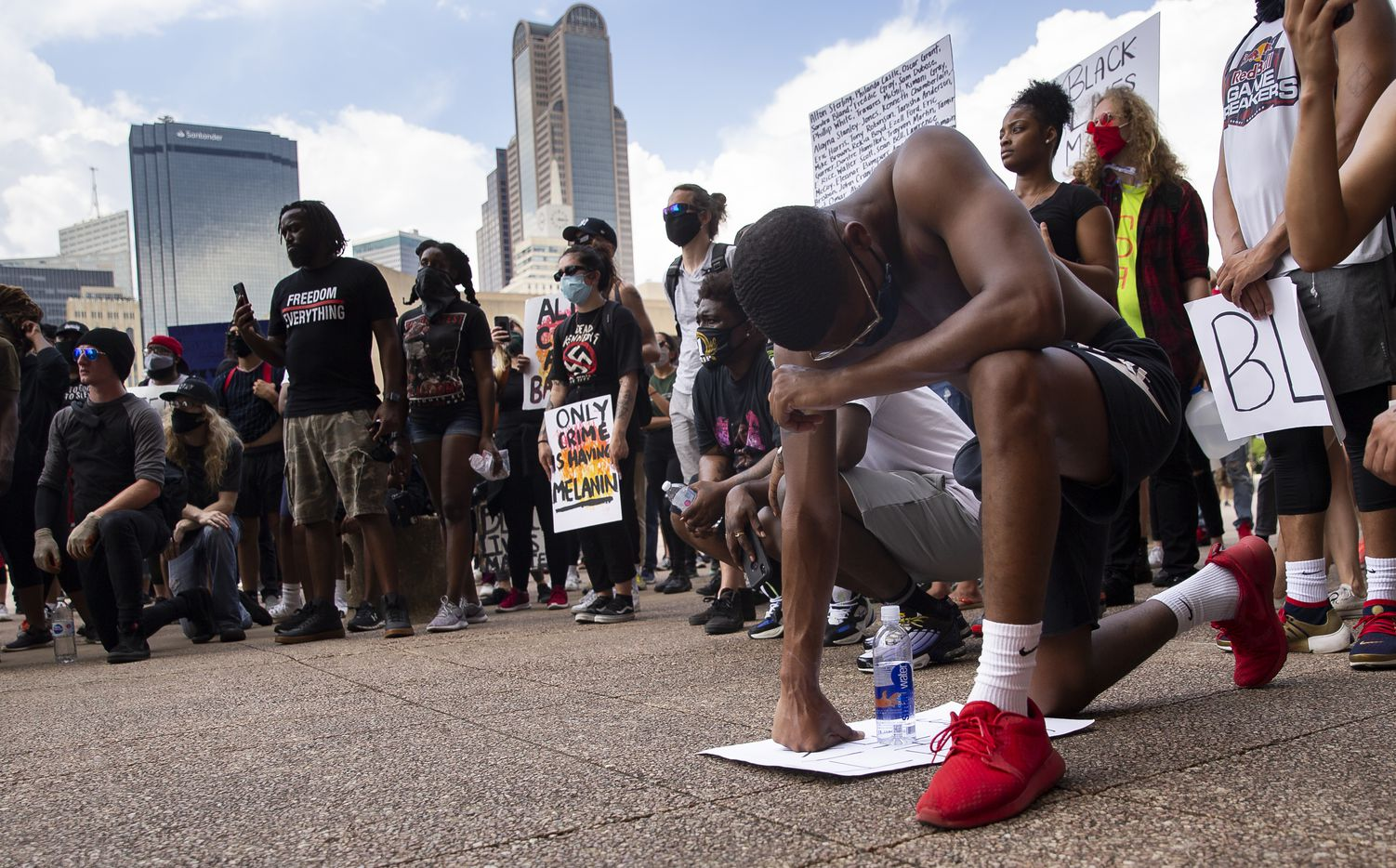 "Ryan Hunter from Fort Worth kneels at Dallas City Hall after peacefully marching through downtown Dallas demonstrating against police brutality on Tuesday, June 2, 2020. ""I'm tired of seeing people that look like me dead in the streets,"" Hunter said."