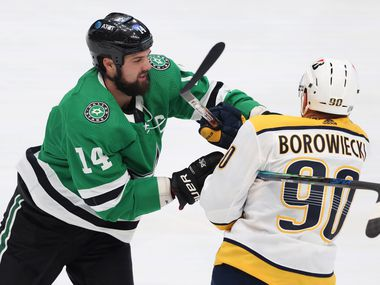 Dallas Stars left wing Jamie Benn (14) and Nashville Predators defenseman Mark Borowiecki (90) get tangled up during the first period of play in the Stars home opener at American Airlines Center on Friday, January 22, 2021in Dallas.