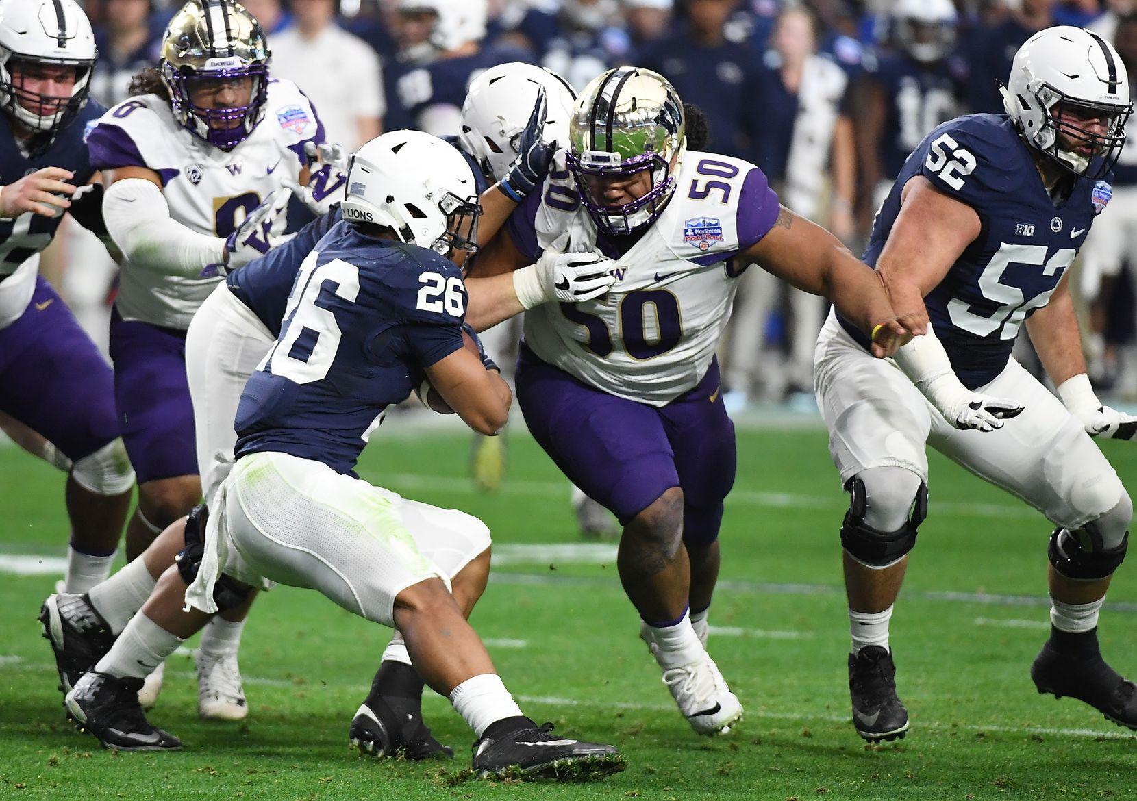 GLENDALE, AZ - DECEMBER 30: Washington defensive tackle Vita Vea (#50) attempts to tackle Penn State running back Saquon Barkley during the Fiesta Bowl at University of Phoenix Stadium on Dec. 30, 2017, in Glendale, Ariz.  (Photo by Norm Hall/Getty Images)