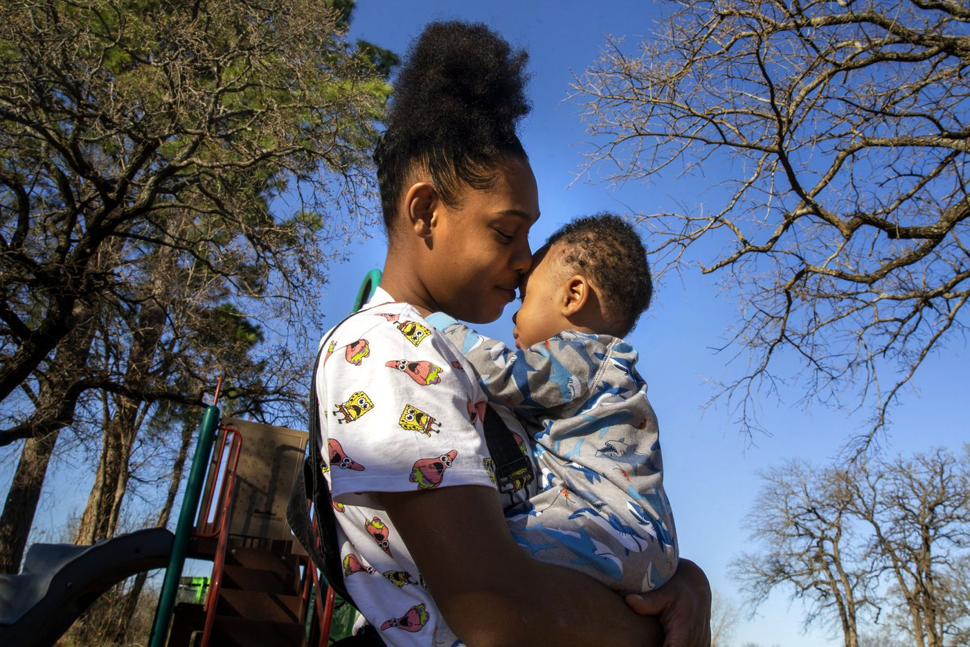 Adrianna Smith, from Pleasant Grove, embraces her 19-month-old child, LaRey, while visiting Joppa Park with local friends in the Joppa neighborhood of South Dallas on Thursday, March 5, 2020.