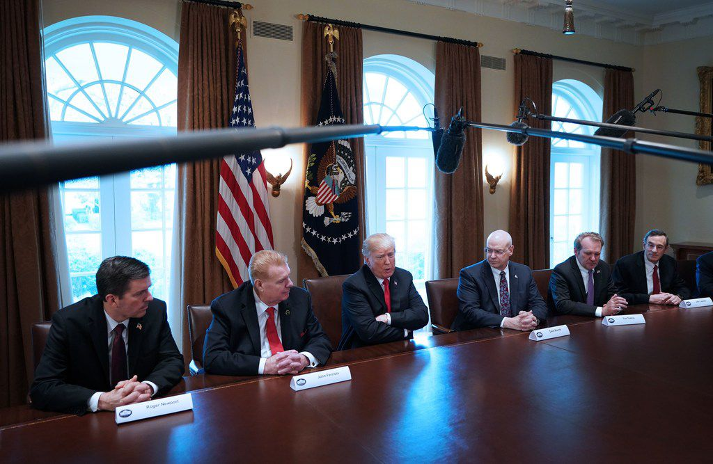 US President Donald Trump speaks on steel and aluminum tariffs during a meeting with industry leaders in the Cabinet Room of the White House on March 1, 2018 in Washington, DC. From left: Roger Newport of AK Steel, John Ferriola of Nucor, and Dave Burritt of US Steel Corporation, Tim Timken of Timken Steel, and John Lapides of United Aluminum.