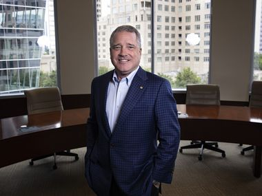Texas Capital Bank CEO Rob Holmes said he wasn't looking for a change when a headhunter approached him in August about heading up the bank.