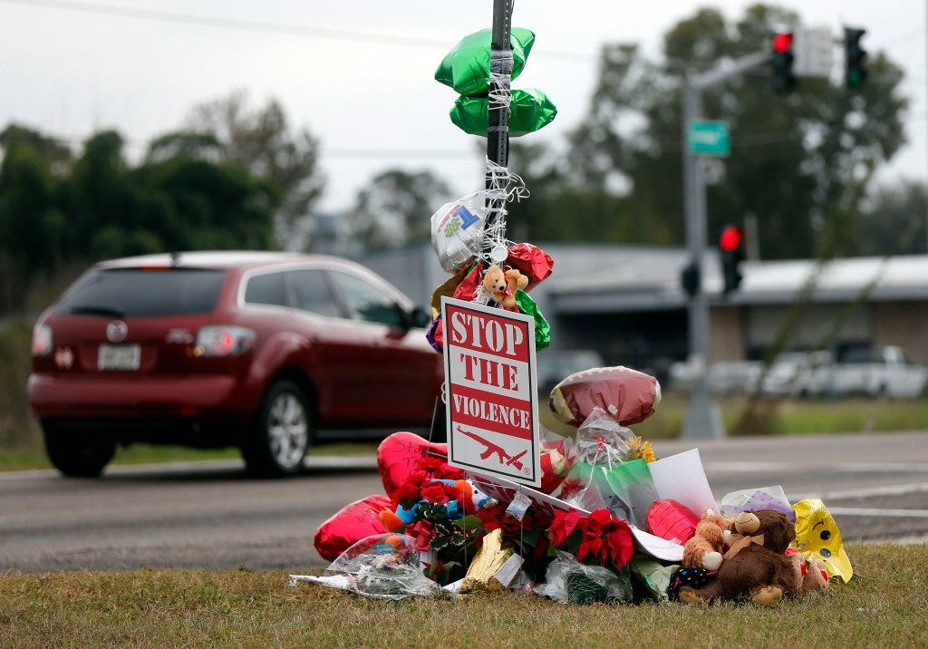 A memorial of flowers and balloons were placed where ex-NFL player Joe McKnight was killed in a road rage incident last week in Terrytown, La. (Gerald Herbert/The Associated Press)