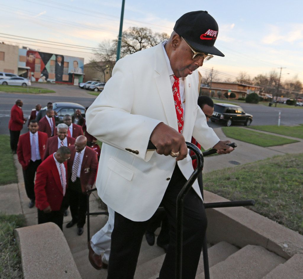 Kappa Alpha Psi 50-year member Stephen Washington climbs the stairs to get to the chapter's house in South Dallas.