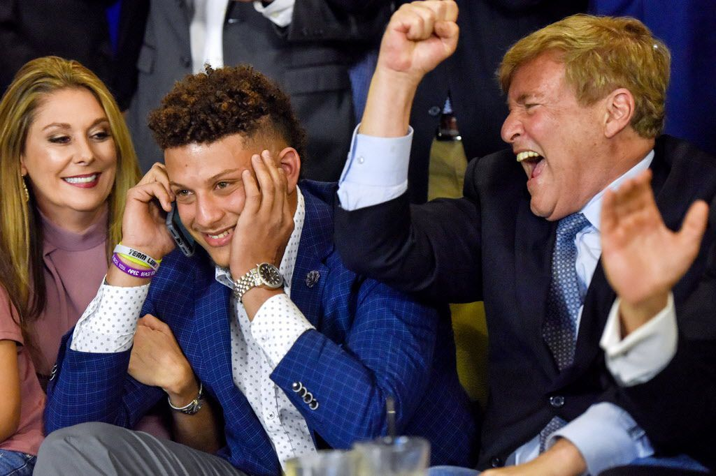 Randi Martin, Patrick Mahomes and Leigh Steinberg react while Mahomes is on a call with the Kansas City Chiefs, during an NFL football draft watch party in Tyler, Texas, Thursday, April 27, 2017. Texas Tech quarterback Mahomes was the 10th overall pick by the Chiefs, after a trade with the Buffalo Bills. (Chelsea Purgahn/Tyler Morning Telegraph via AP)