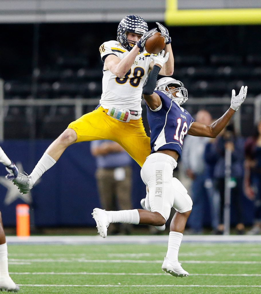 Highland Park's Cade Saustad (88) leaps over Manvel's Trent Gordon (18) for a reception before running it in for a touchdown during the first half of play of the UIL Class 5A Division II state football championship at AT&T Stadium in Arlington, Texas on Friday, December 22, 2017. (Vernon Bryant/The Dallas Morning News)