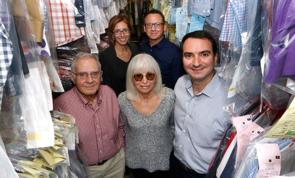 Frank Ashmore Sr., president of Sunshine Laundry and Dry Cleaners Inc., from left, Edna Ashmore,  Frank Ashmore, Jr. Stephanie Ingram, left back row, and Mike Ingram. The family owned business recently celebrated its 75th anniversary. (David Woo/The Dallas Morning News)