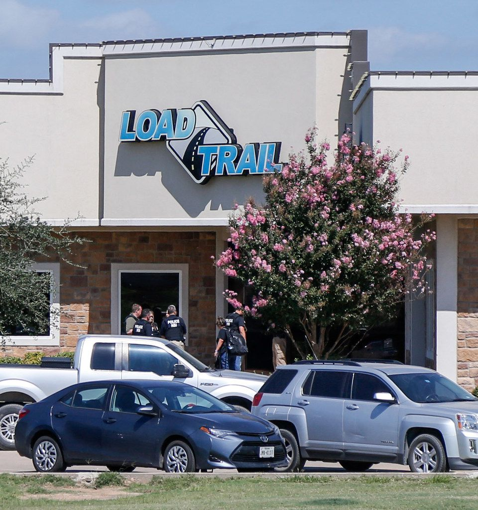 U.S. Immigration and Customs Enforcement agents stood at the front door of Load Trail in Sumner, Texas, on Aug. 28, 2018.