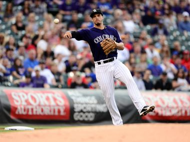 May 5, 2014; Denver, CO, USA; Colorado Rockies third baseman Nolan Arenado (28) throws to first base in the first inning against the Texas Rangers at Coors Field. Mandatory Credit: Ron Chenoy-USA TODAY Sports