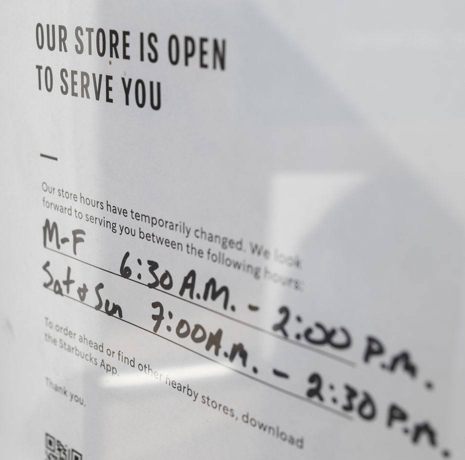 Signage posted on the Starbucks location at Preston Road and Alpha Road in Dallas informing customers of their limited hours, on Jan. 14, 2021. Starbucks locations are changing their hours due to lack of employees as some have been quarantined for COVID-19.