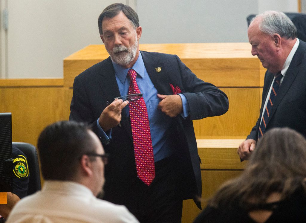 Defense attorneys Stephen Miller, center, and John Tatum, right, take their seats during a trial charging Charles Phifer faces with felony injury to a child on Wednesday, October 10, 2018 at the Frank Crowley Courts Building in Dallas. The charge is for the March 2016 beating death of 4-year-old Leiliana Wright. (Ashley Landis/The Dallas Morning News)