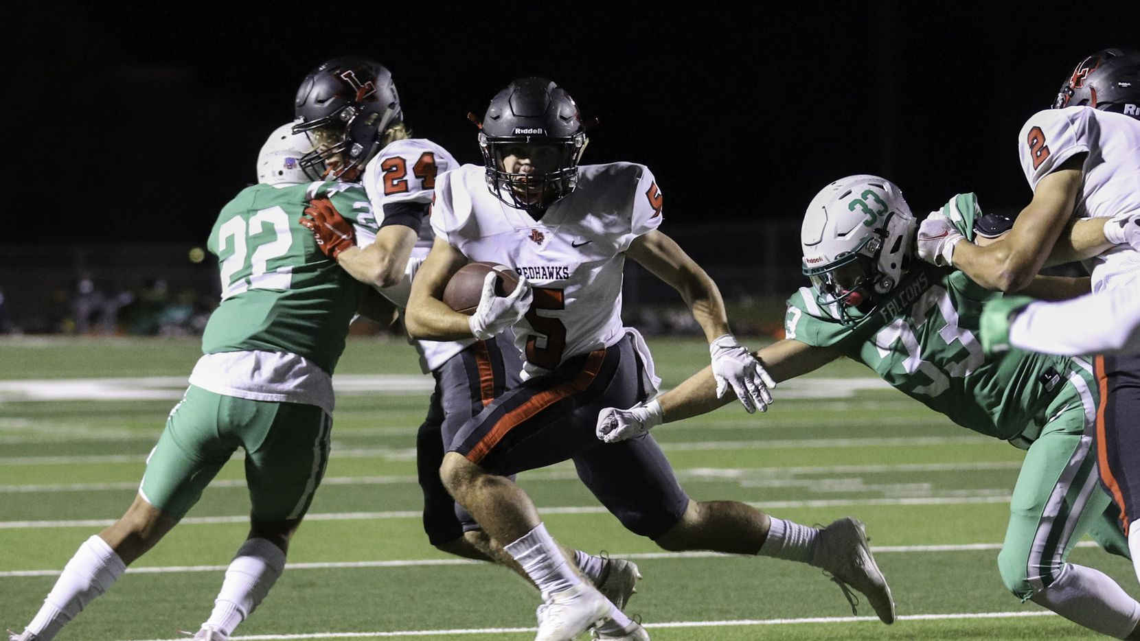 Lake Dallas linebacker Patrick Wenger (33) tries to bring down Frisco Liberty running back Will Ashmore (5) during the first half at Falcon Stadium in Corinth, Texas Friday, October 23, 2020.