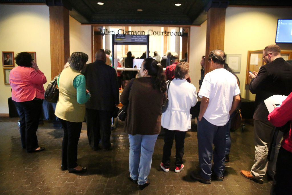 "People wait outside the Dallas County Commissioners Court meeting in Dallas on Tuesday, Feb. 7, 2017. More than a dozen D-FW advocacy groups gathered in support of a ""Welcoming Communities"""" resolution, which serves as a proclamation to all residents that Dallas County supports immigrant, refugee, and marginalized communities, documented and undocumented, and values them as integral members of our community.  (Rose Baca/The Dallas Morning News)"