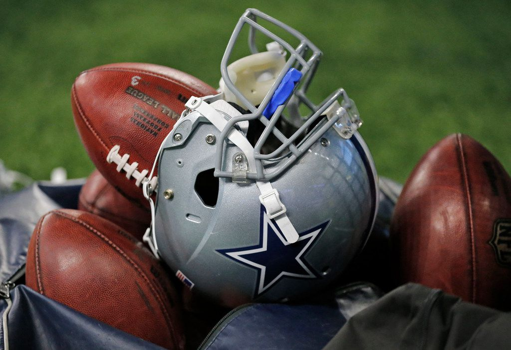 A Dallas Cowboys helmet sits on the top of a bag of footballs at the Dallas Cowboys vs. the Indianapolis Colts NFL football game at Lucas Oil Stadium in Indianapolis on Sunday, December 16, 2018.
