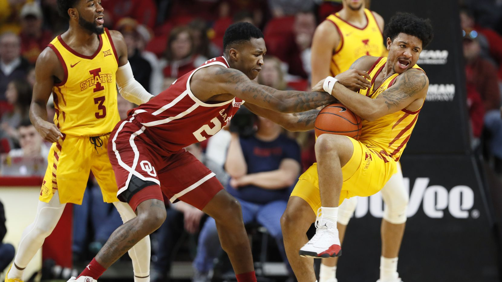 Oklahoma forward Kristian Doolittle is fouled by Iowa State guard Prentiss Nixon, right, during the second half of an NCAA college basketball game, Saturday, Jan. 11, 2020, in Ames, Iowa.